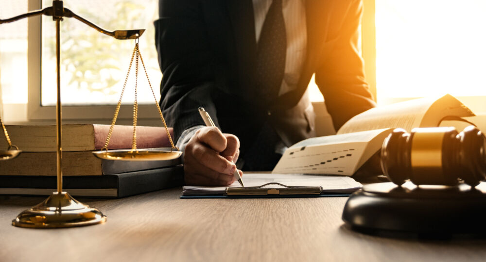 Male,Lawyer,Working,With,Contract,Papers,And,Wooden,Gavel,On